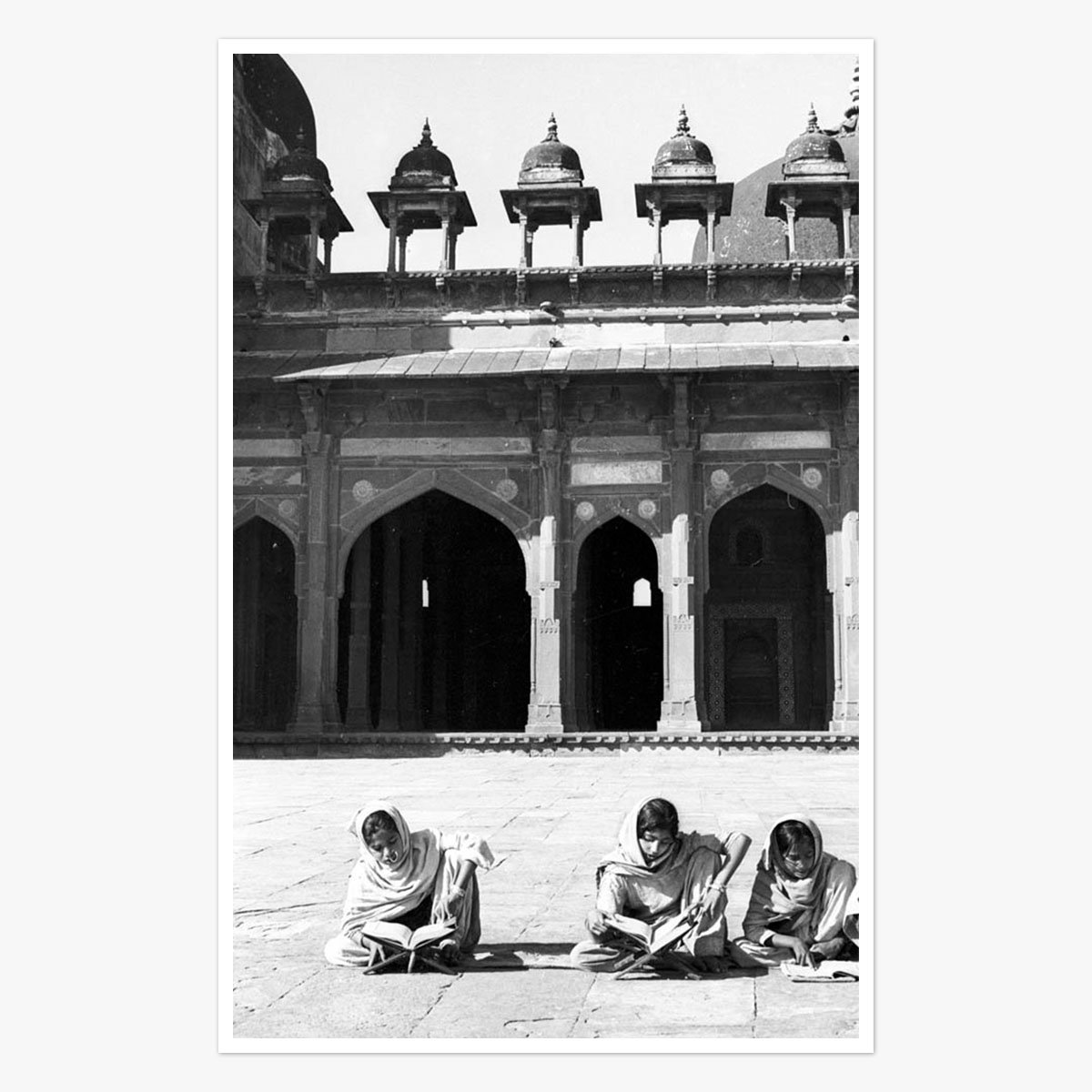 Young girls reading the Koran outside of a mosque by Marilyn Stafford