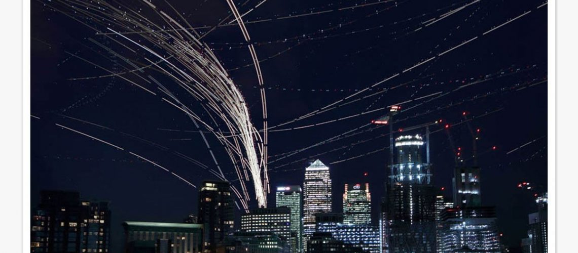 Aircraft-pass-over-Canary-Wharf-by-Roger-Jackson-print