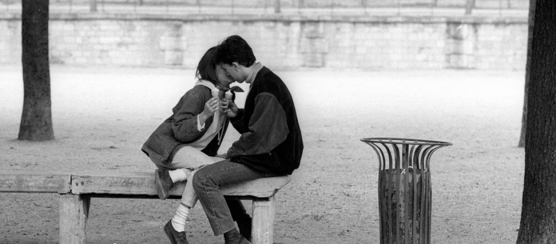 KISS IN THE JARDIN DES TUILERIES, Paris France.1988. This 'Kiss' picture was the first of many made when travelling the world…I've always enjoyed the challenge of making images of quiet moments, one frame and move on. Nikon FM2, 105mm lens and Kodak Tri-X film. COPYRIGHT PHOTOGRAPH BY BRIAN HARRIS  © 1988 07808-579804